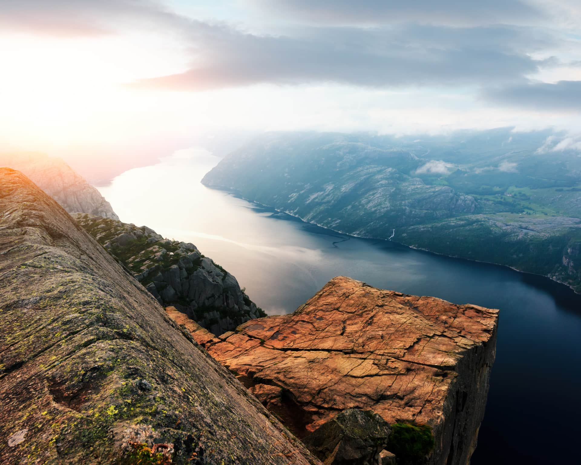 Colourful sunrise on Preikestolen (pulpit-rock) - famous tourist attraction in the municipality of Forsand in Rogaland county, Norway.