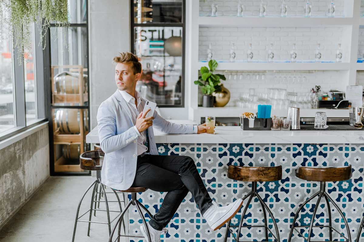 Entrepreneur working in a coffee shop but using a virtual office to be professional