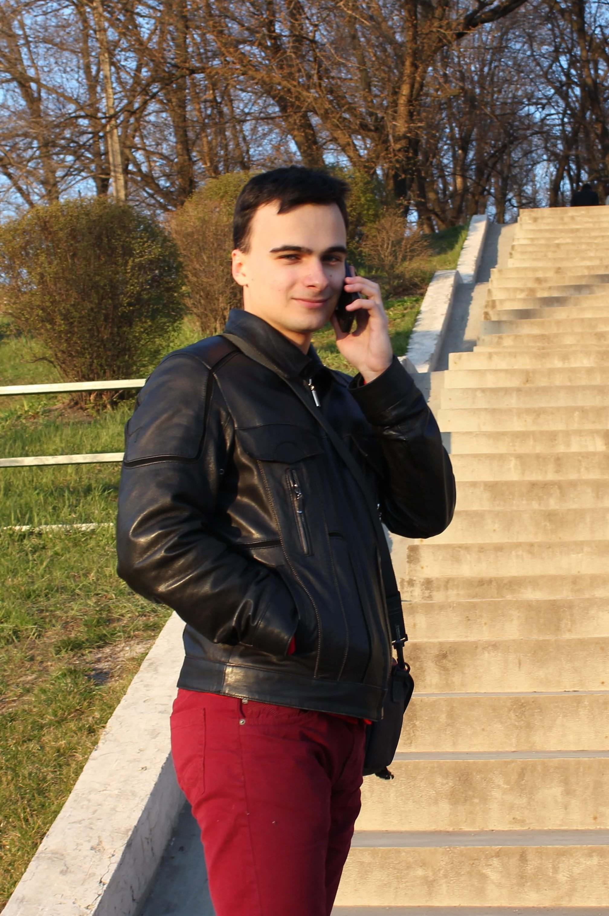 Vlad takes a client call while taking a walk through x.