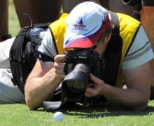A photographer takes a close up photo of Tiger Woods's ball during the Pro-Am for the Australian Masters tournament at the Kingston Heath golf course, his first tournament in Australia for 11 years, in Melbourne on November 11, 2009. Woods, who is reportedly being paid three million US dollars to play in this week's European Tour co-sanctioned event, will attract massive public galleries at the Kingston Heath sandbelt course. All 25,000 tickets for each of the four days of the tournament were sold out early last month, with reports that officials are anticipating crowds of up to 15 deep behind the ropes following Woods. AFP PHOTO/William WEST (Photo credit should read WILLIAM WEST/AFP/Getty Images)