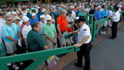 AUGUSTA, GA - APRIL 02: A security gaurd opens the gate to allow patrons entrance during a practice round prior to the start of the 2012 Masters Tournament at Augusta National Golf Club on April 2, 2012 in Augusta, Georgia. (Photo by Streeter Lecka/Getty Images)