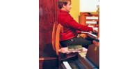 Help Aaron get new piano for studies.