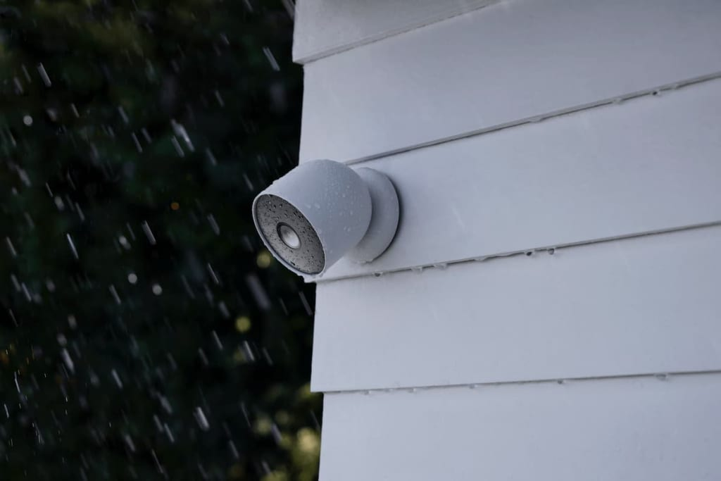 a google nest cam in the rain, fixed to a wall
