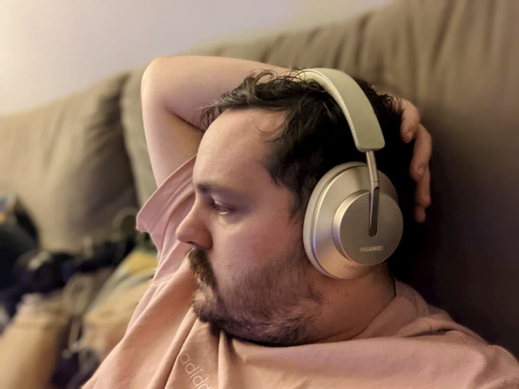 Gold Huawei headphones