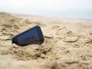 phone on a beach enjoying removal of roaming charges