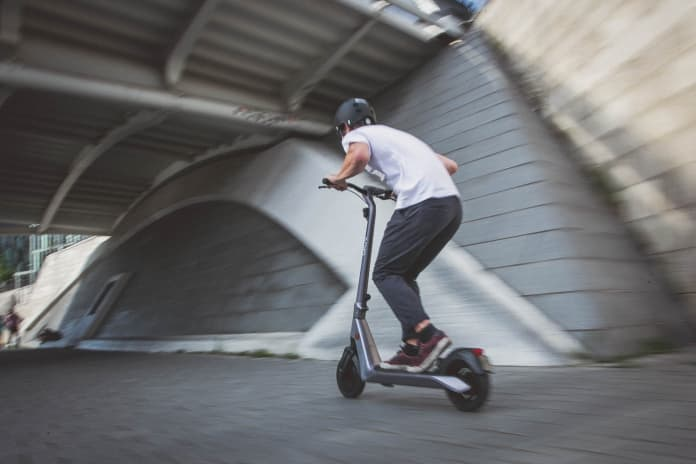 electric scooter rider in a tunnel