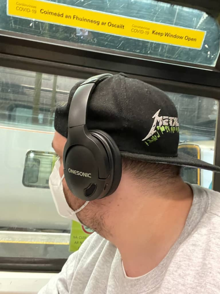 onesonic headphones anc on a train