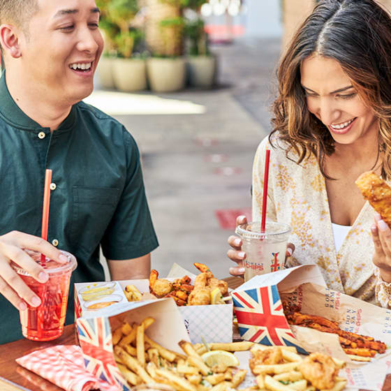 Photo of woman with assortment of combos, fries and drink