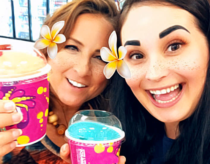 two Brierley employees posing at 7 11 free slurpee day