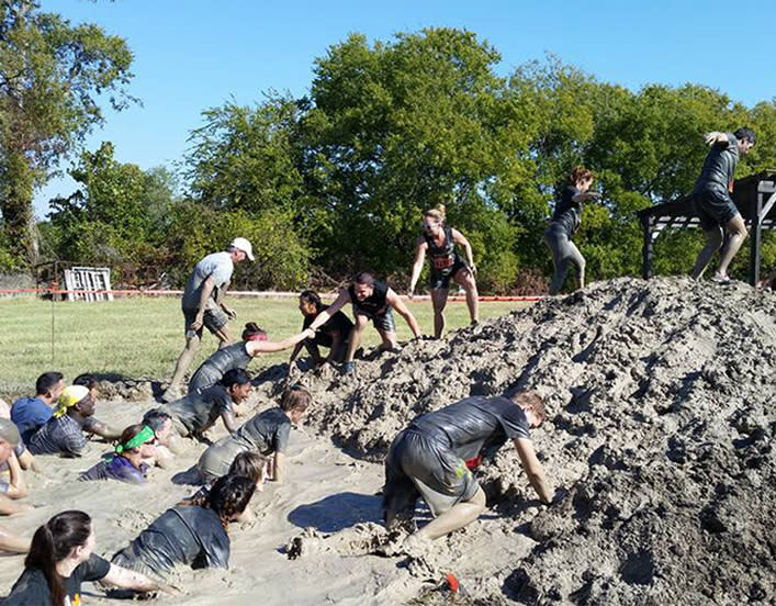 brierley employees participating in a mud run together