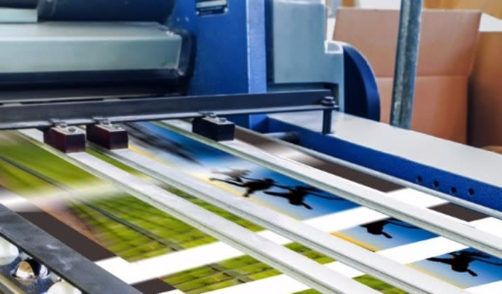 large printer printing out direct mail marketing collateral