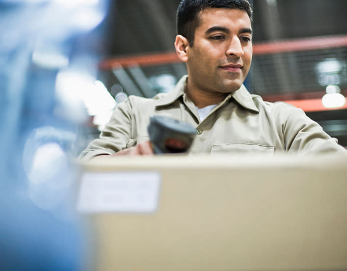 image of a shipping supplier preparing a direct mail marketing package