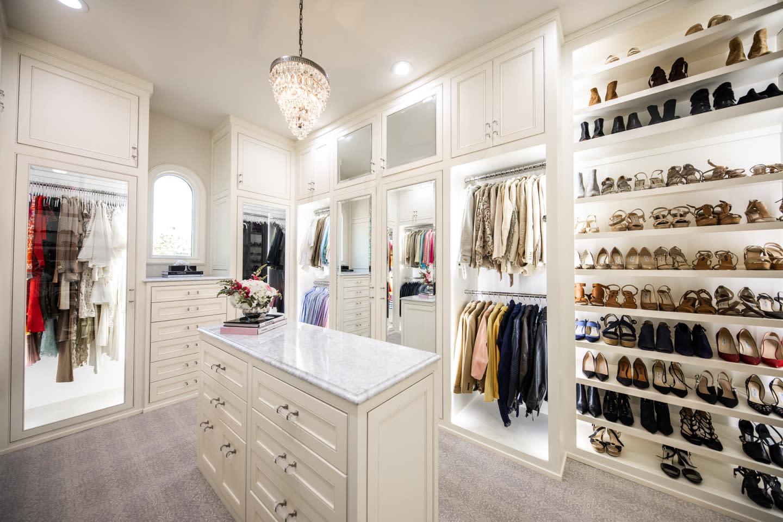 white closet with shoe storage