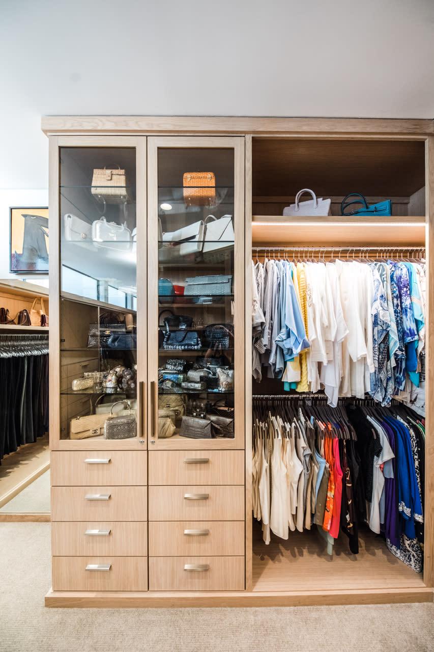 walk in closet with handbag display