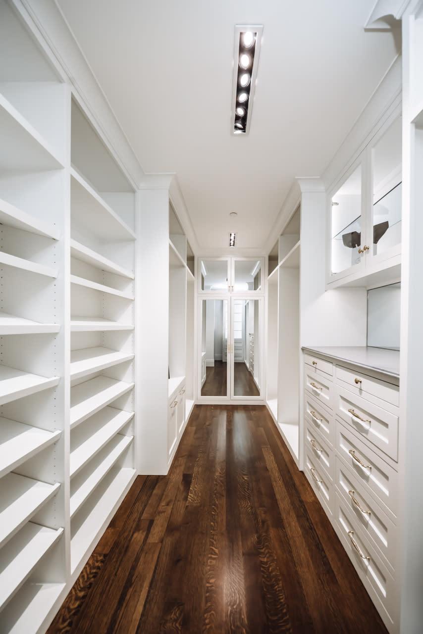 walk in closet with mirrored doors