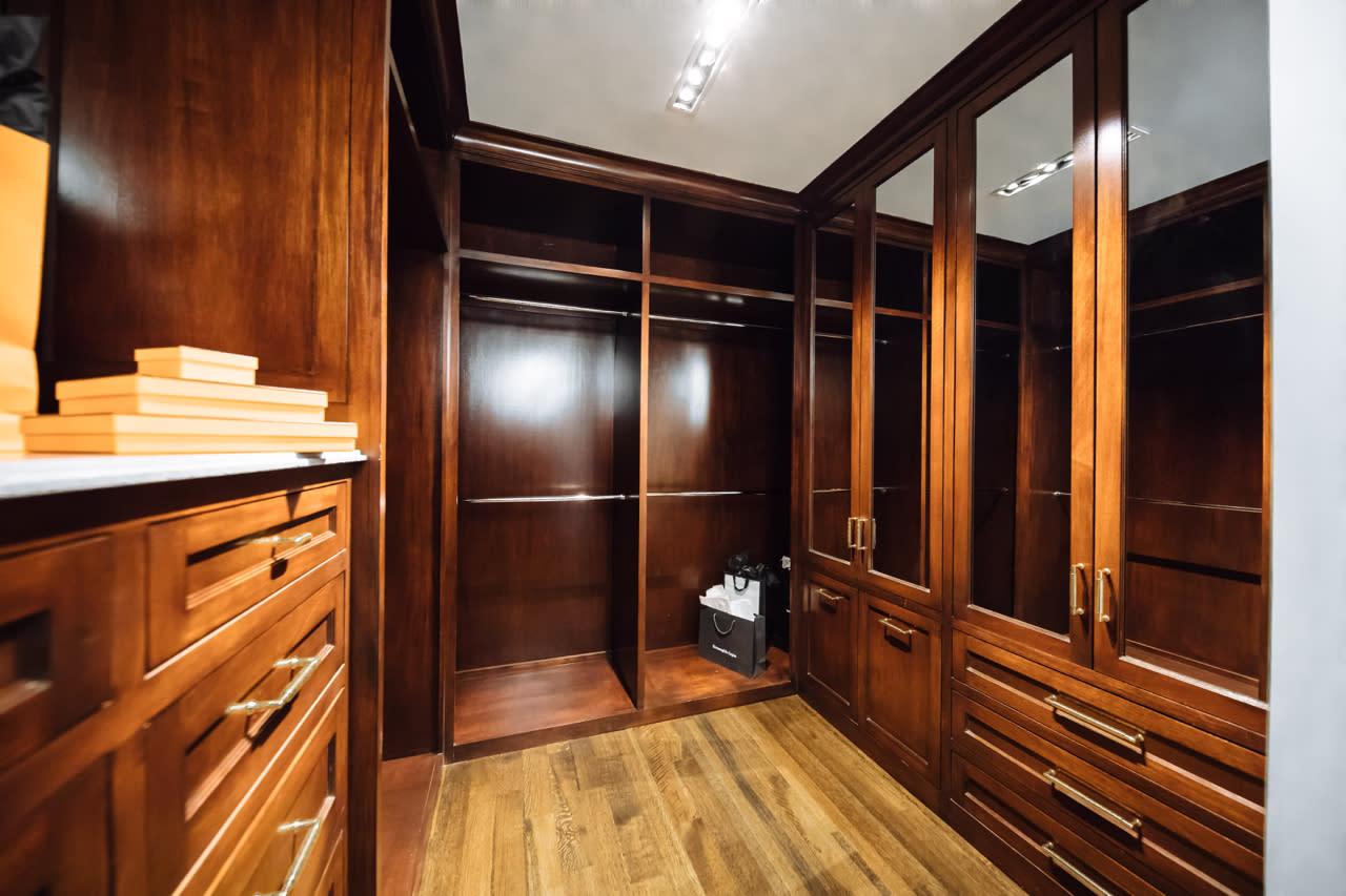 walk in custom closet stained mahogany