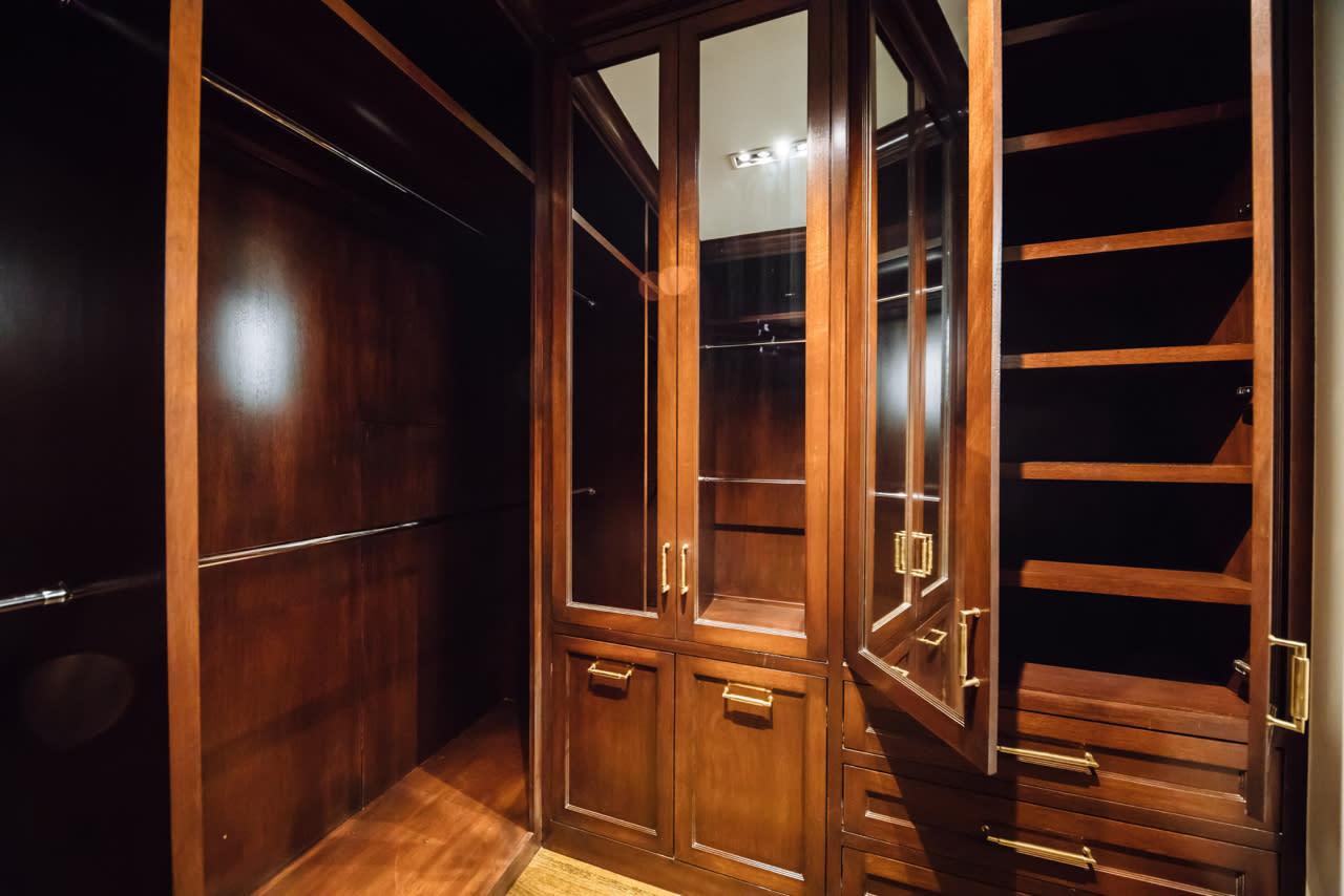 wood closet with mirrored doors
