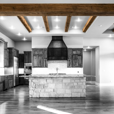 A giant Oak wood beam girder holding open a space to the kitchen.