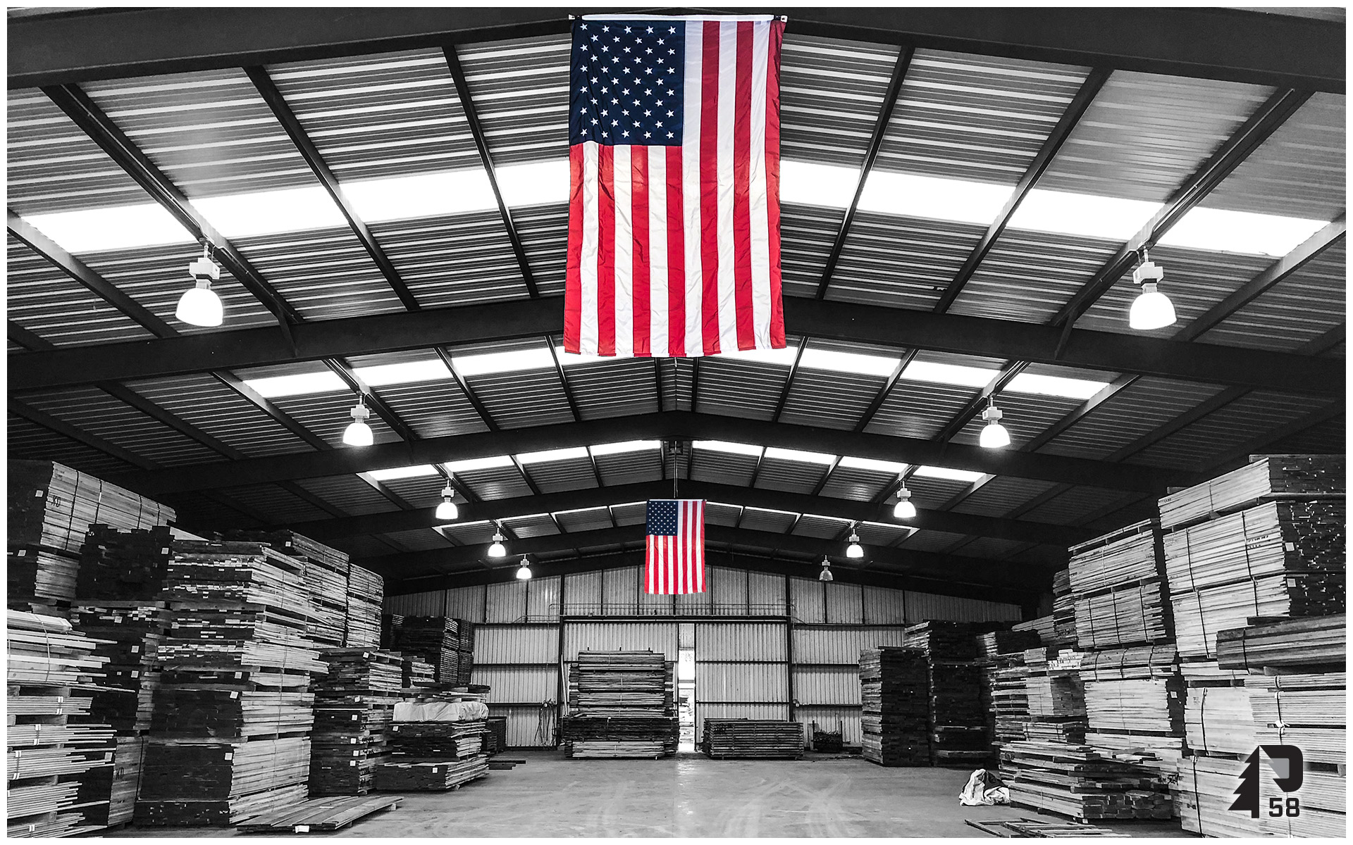 Kiln dried lumber in Texas with American Flags hanging.