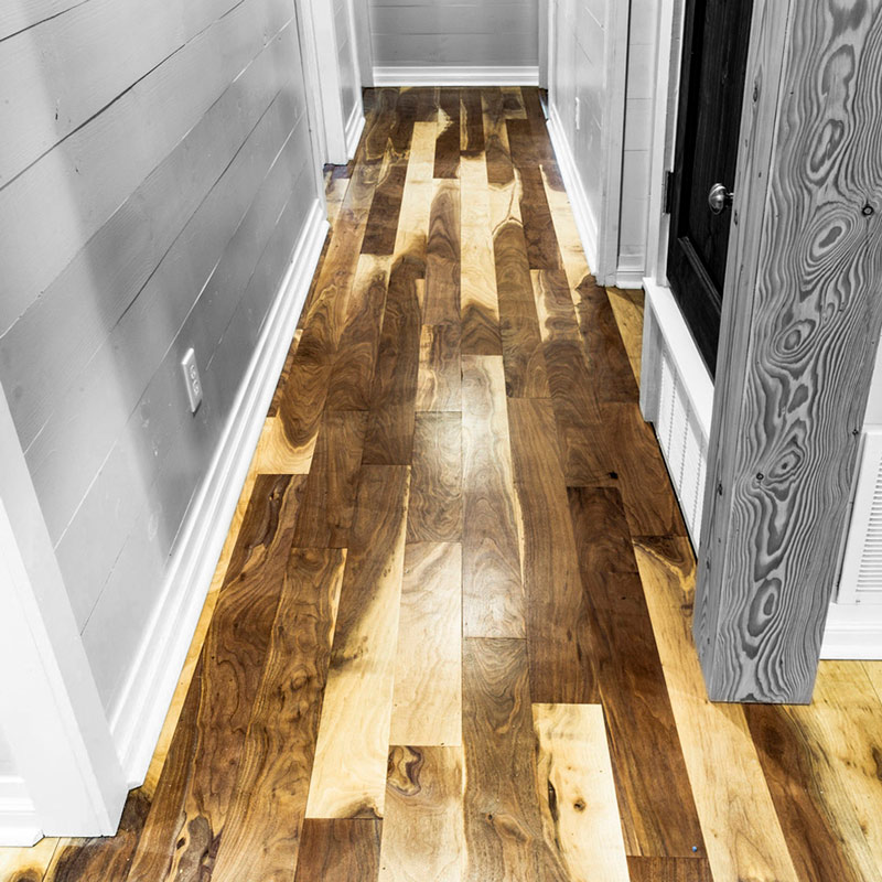 Sappy Walnut wood flooring in a hallway.