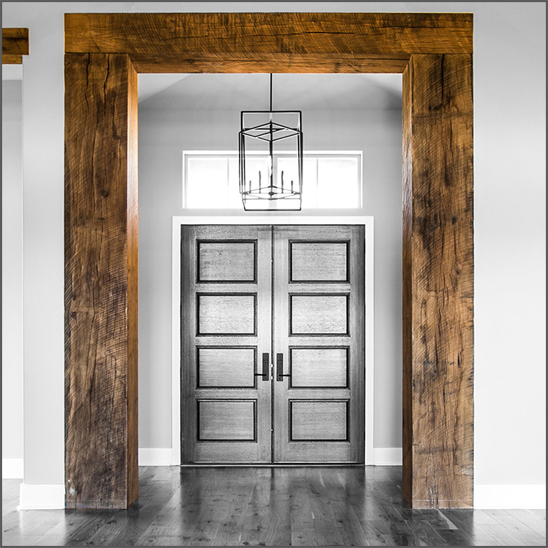 Rustic Oak wood beams as a threshold around a door in Texas.