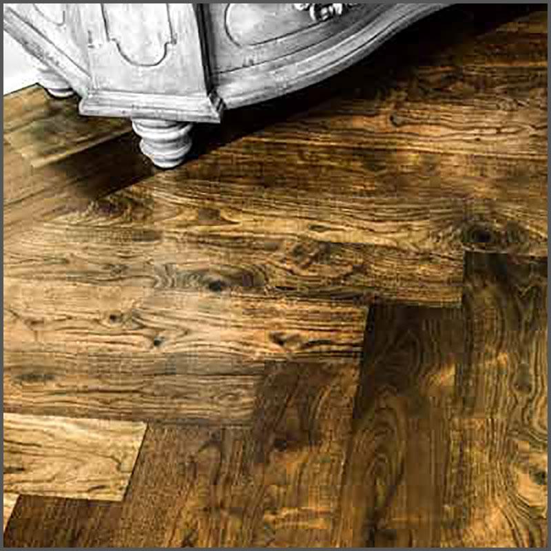 Engineered Walnut hardwood flooring in a herringbone pattern.