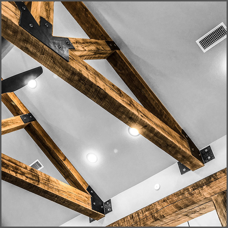 White Oak beams make a Howe Truss in modern ranch style home.