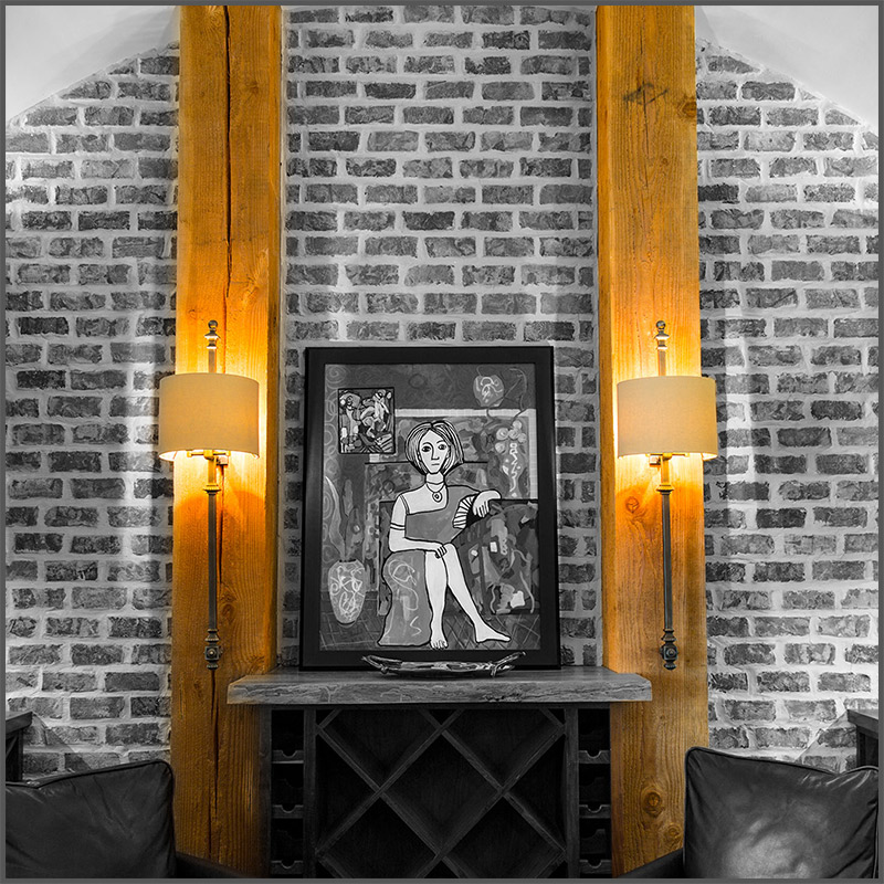 Douglas Fir beams in a wine room frame a piece of art by Texarkana artist Polly Cook.