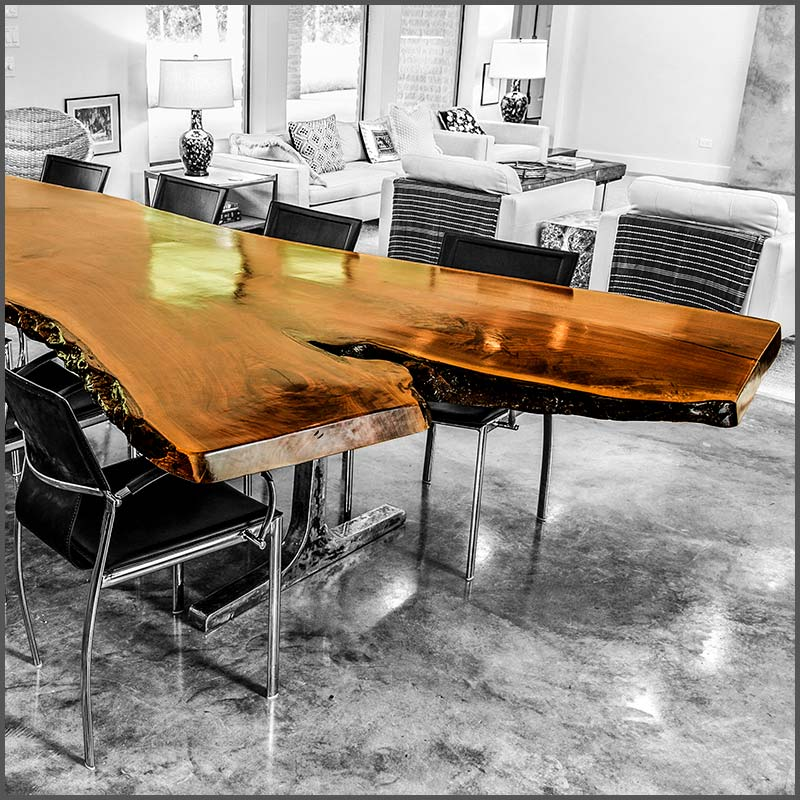 Live edge Walnut wood slab dining table with steel legs.