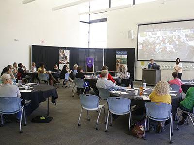 large group of teachers watching presentation