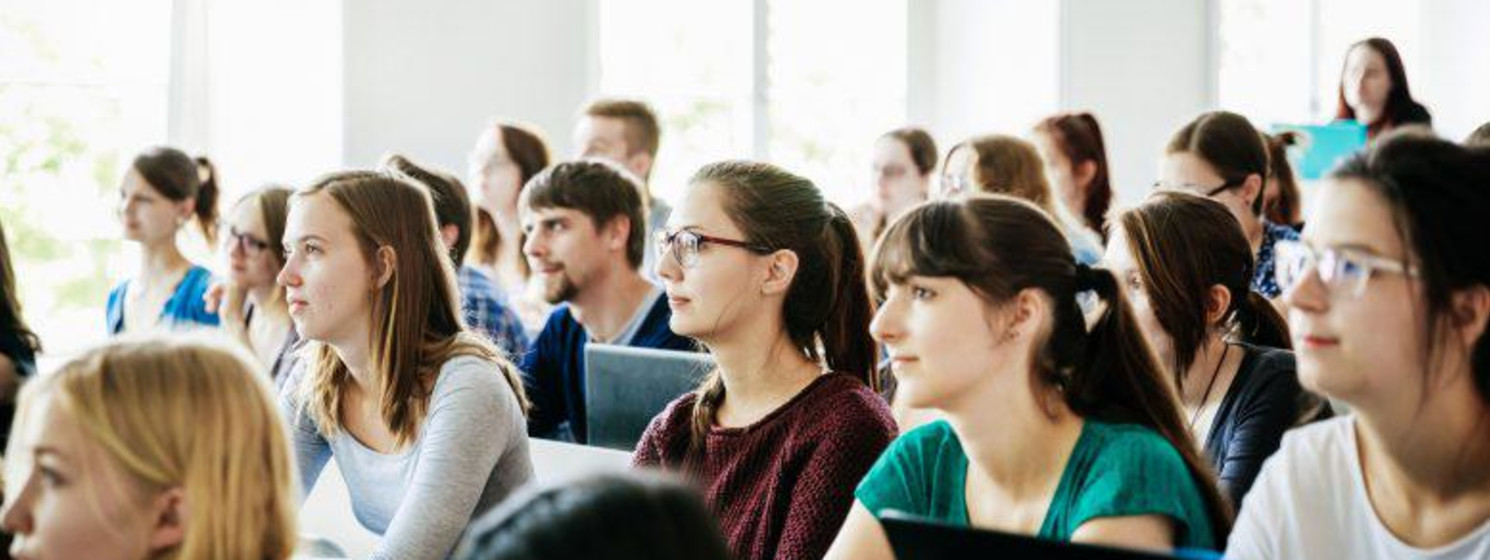 University Students Listening And Concentrating During Lecture