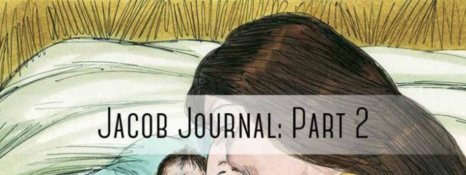 """woman holding baby with """"jacob journal part 2"""" written on it"""