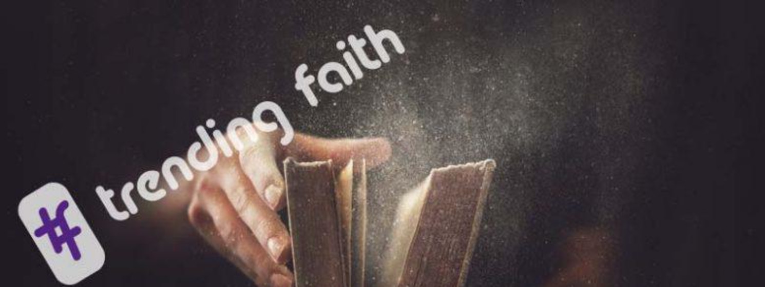 Trending faith logo over a dusty book