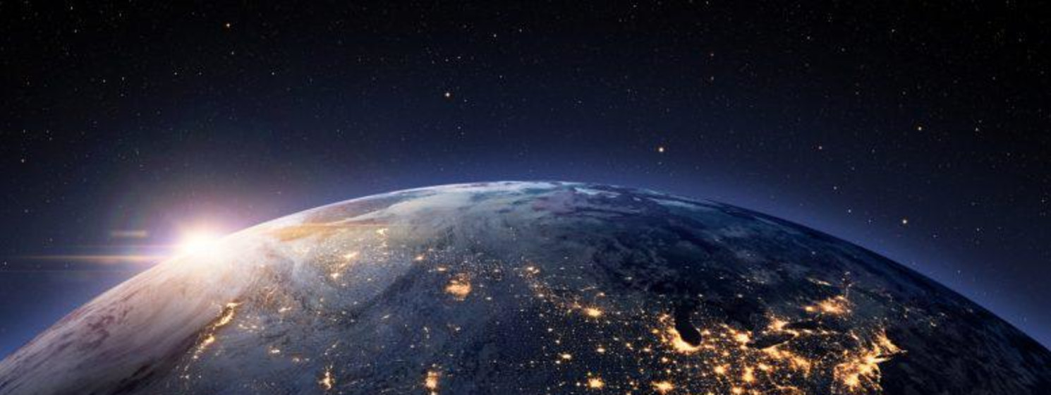 Space view of the US lit up with the sun in the northwest horizon