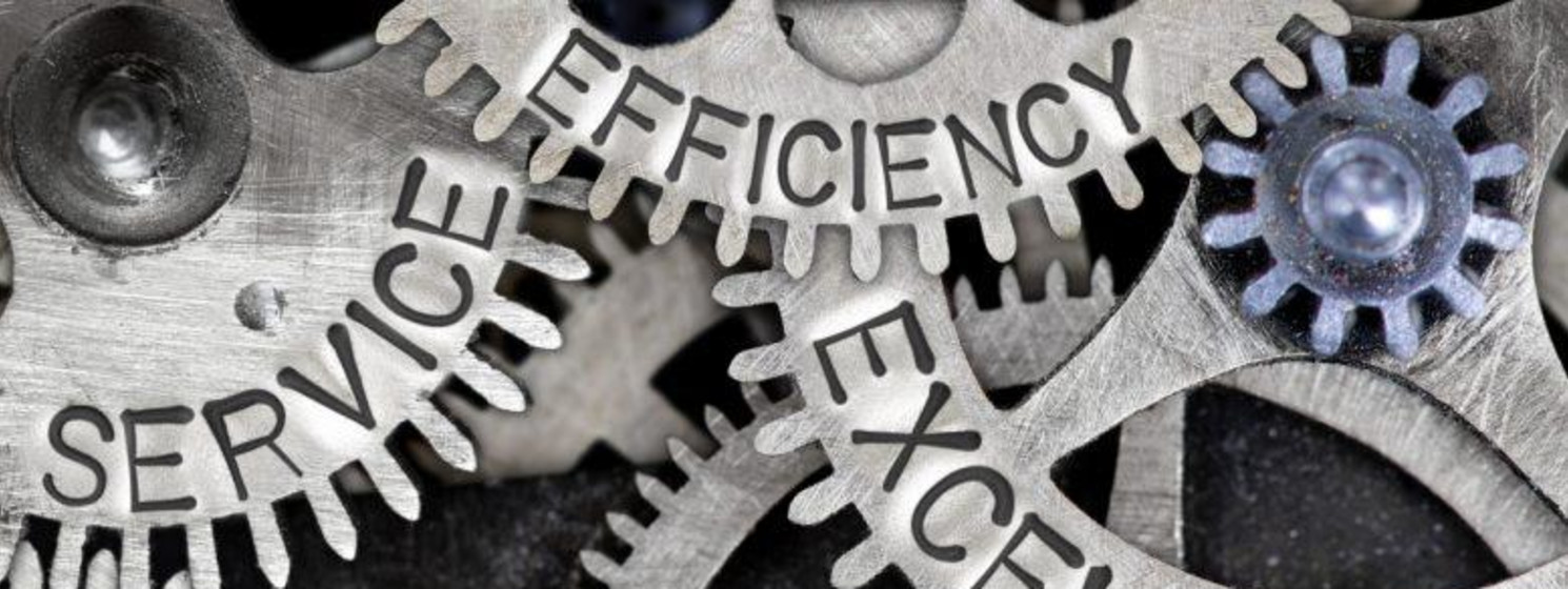 """Gears engraved with the words """"efficiency,"""" """"excellence,"""" """"support,"""" """"trust"""" and """"efficiency"""""""