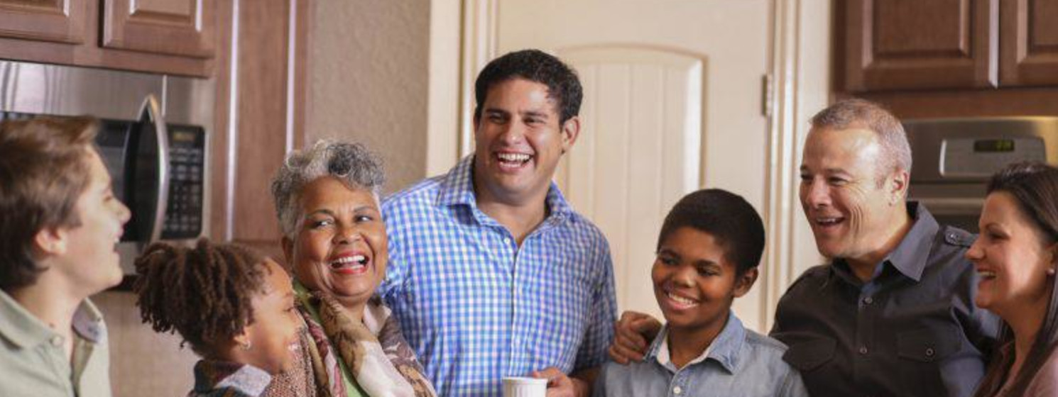 family smiling and laughing in the kitchen