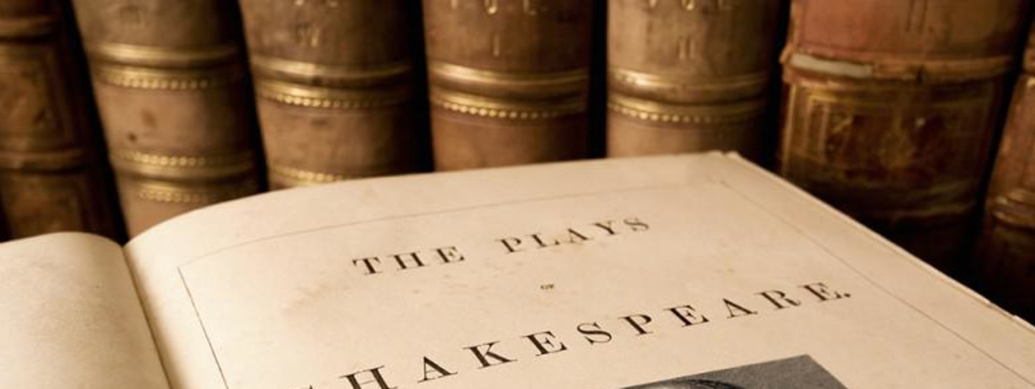 a book open to William Shakespeare