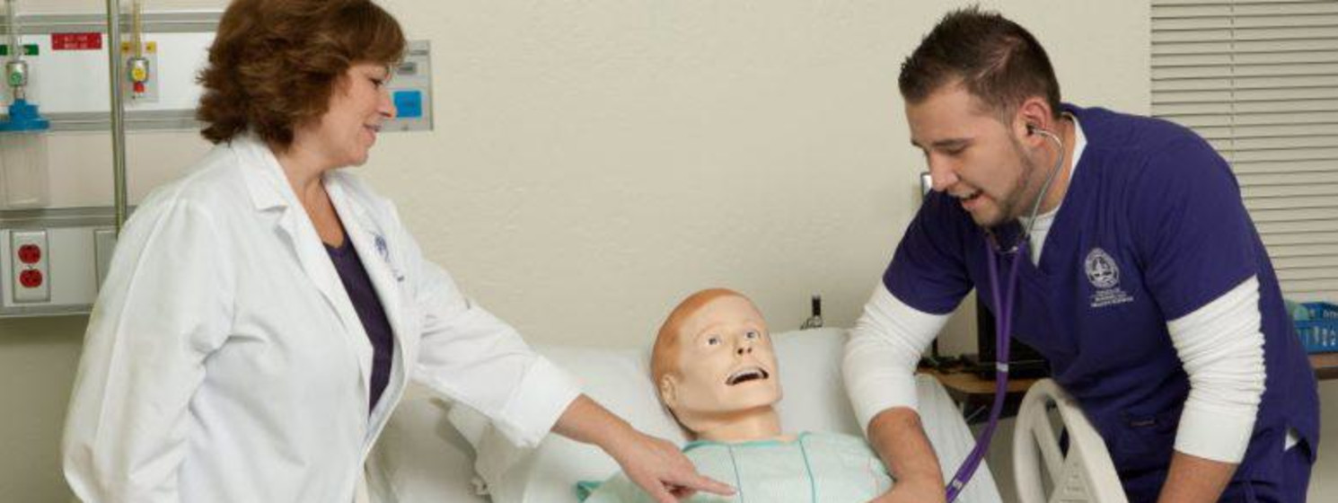 nursing student working with a doctor