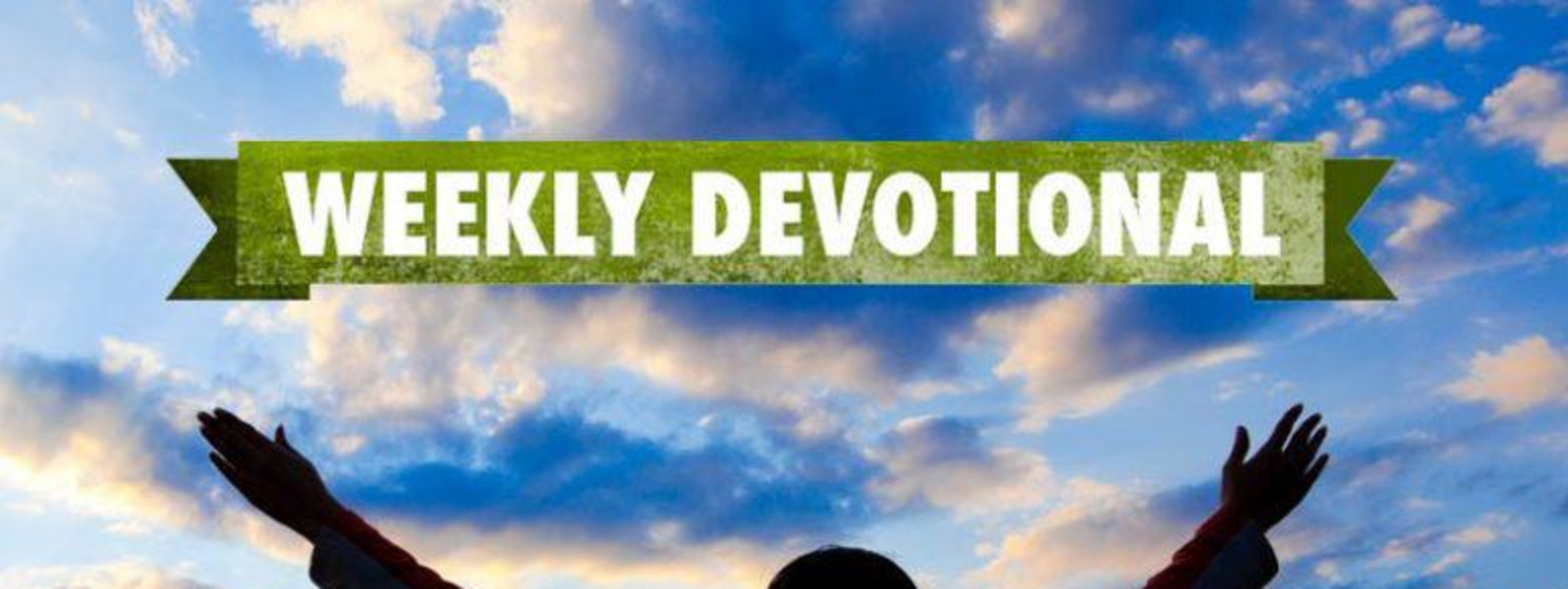 Weekly Devotional: Person with their hands up looking at the sunset