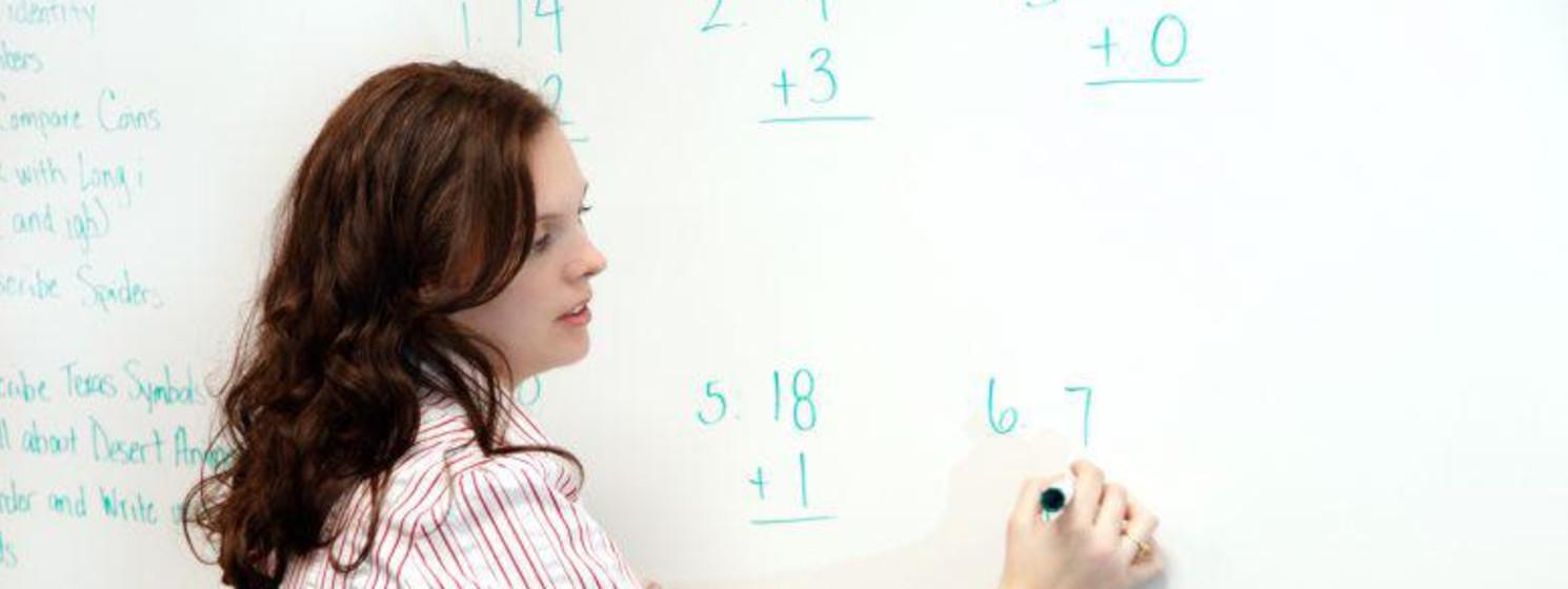 math teacher writing on a white board