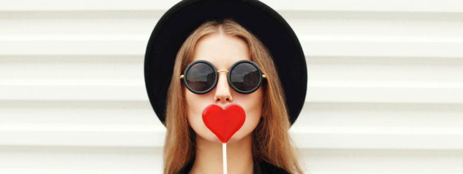 Girl with a heart-shaped lollipop