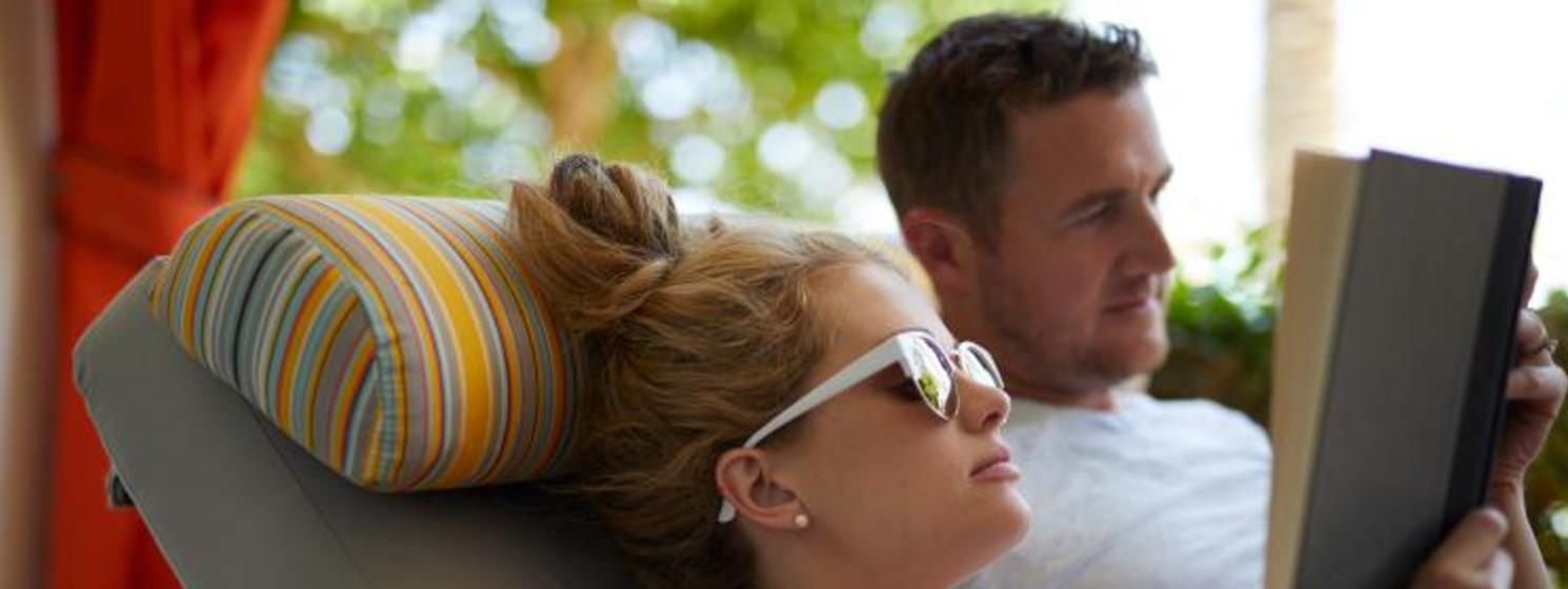 boyfriend and girlfriend reading a book