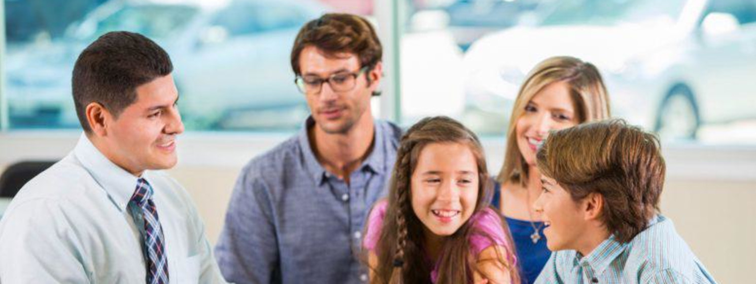 Family counselor asks kids questions with parents behind them