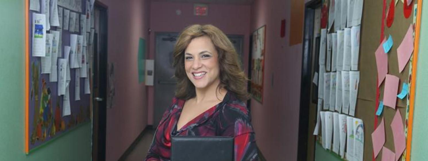 Teacher or administrator in school hallway