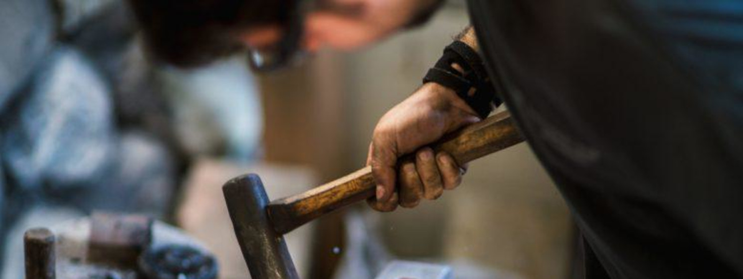 A blacksmith working with metal
