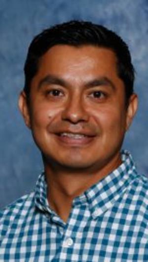 Dr. Sammy Alfaro posing for a headshot