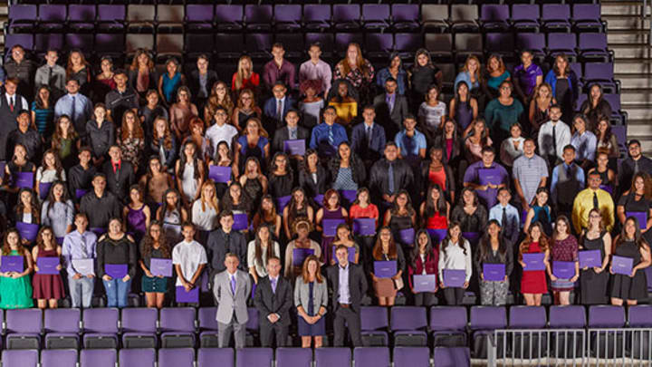 Large group of students pose for picture in GCU Arena