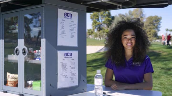 students working on GCU golf course beverage cart