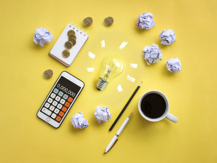 Financial planning set-up with a calculator and notepad