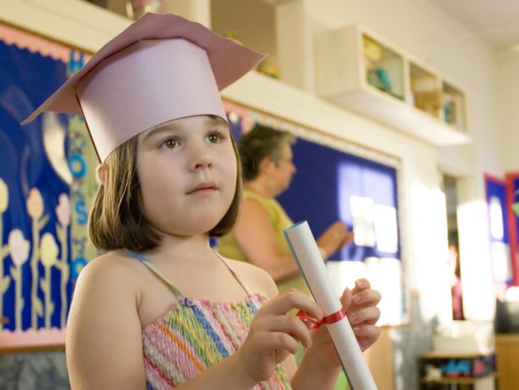 kindergarten graduate in paper cap